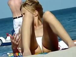 2 min - Hidden cam vid with 2 topless girls sunbathing on a beach