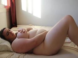 17 min - Fat girlie rolls on the bed and fingers herself hard